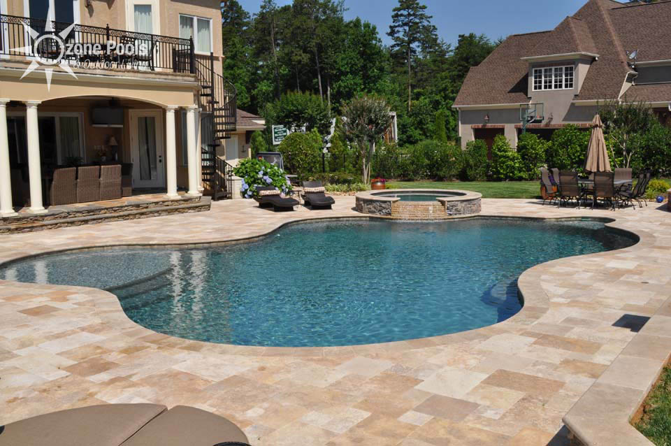 freeform pool spa with travertine and fire features