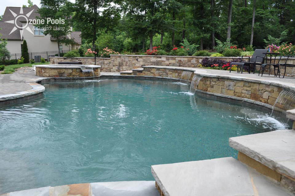 Freeform PoolSpa with Stone Retaining Wall