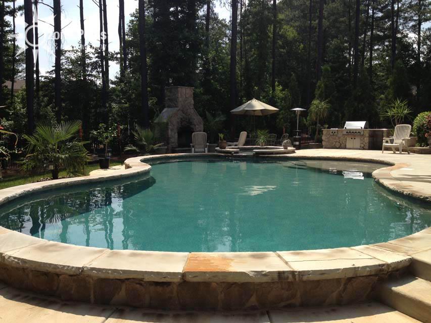 Custom Freeform Pool With Exposed Bond Beam With Stone Finish