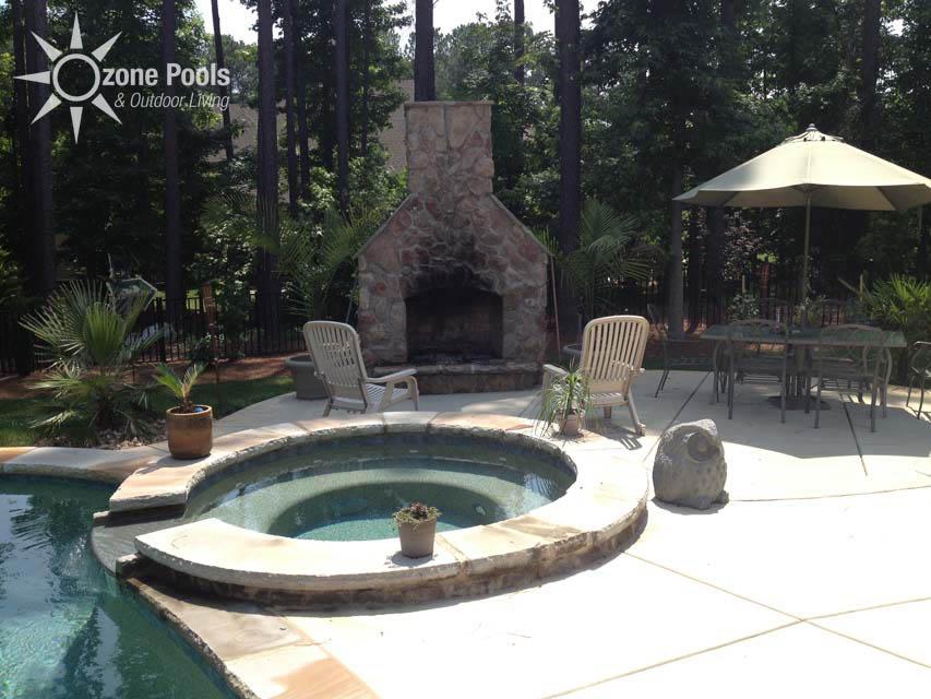 Custom freeform pool with exposed bond beam with stone finish - Fibreglass swimming pool bond beam ...