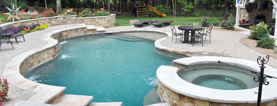 Freeform Pool & Spa with Stone Retaining Wall
