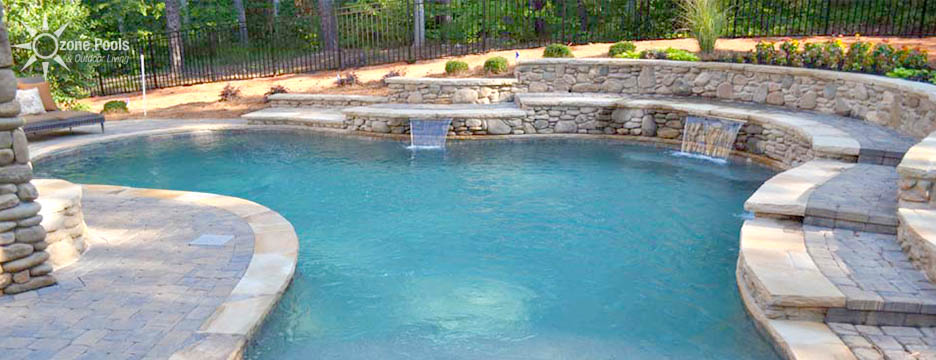 Cobblestone Pool with Outdoor Kitchen & Fireplace